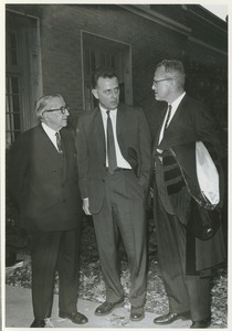 Thumbnail of Dr. Frank L. Boyden, Prof. William H. Ross, and President John W. Lederle in front of Memorial Hall after the Centennial Convocation