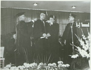 Thumbnail of Charles Avila at his hooding ceremony during the Centennial Charter Day convocation
