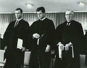 Thumbnail of Governor Endicott Peabody, Senator Edward Kennedy, and James T. Nicholson standing at Charter Day convocation