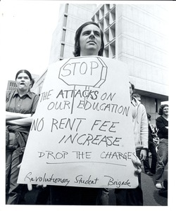 Thumbnail of Board of Trustees fee increase demonstration: student holding sign
