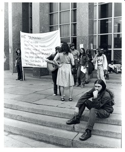 Thumbnail of Board of Trustees fee increase demonstration: protestors on the steps of the Student Union, Charles Bagli with sign (far left)