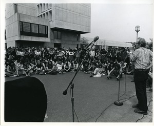 Thumbnail of Board of Trustees fee increase demonstration: Vice Chancellor for Student Affairs Robert W. Gage speaking to protestors, Herter Hall in background
