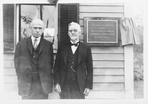 Thumbnail of Jewell B. Knight (class of 1892) and Ephraim P. Felt (class of 1891) at the       Insectary, with plaque reading 'This building erected 1889 was the original home of       Economic Entomology at this college'