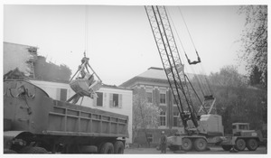 Thumbnail of Wrecking of the Mathematics Building (formerly the Entomology Building) removing demolition debris; Fernald Hall in the background