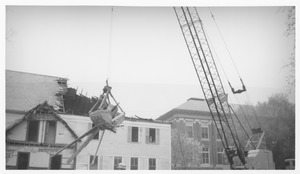 Thumbnail of Wrecking of the Mathematics Building (formerly known as the Entomology Building) crane demolishing the building; Fernald Hall in the background