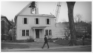 Thumbnail of Wrecking of the Mathematics Building (formerly known as the Entomology Building) man walking past the building with demolition in progress