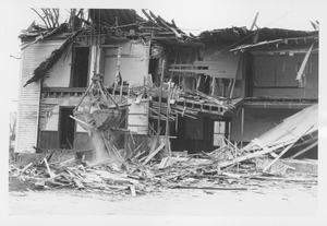 Thumbnail of Wreckage of the Mathematics Building with bucket in operation