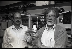 Thumbnail of Louis Carpino (right) and unidentified colleague Carpino and colleague holding up bottles