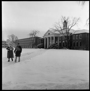 Thumbnail of Students walking out of Goodell Library on a snowy day, with Bartlett Hall in             the background