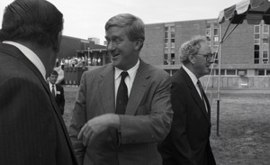 Thumbnail of Ceremonial groundbreaking for the Conte Center: unidentified man chatting with             Gov. William Weld, Richard O'Brien in background