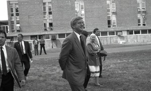 Thumbnail of Ceremonial groundbreaking for the Conte Center: Gov. William Weld walking to the             site of groundbreaking, Corinne Conte in background
