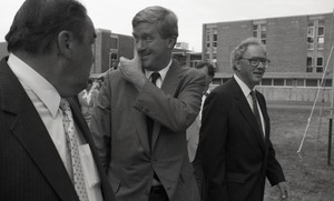 Thumbnail of Ceremonial groundbreaking for the Conte Center: unidentified man, Gov. William             Weld, and or Richard O'Brien walking to the site of groundbreaking