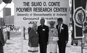 Thumbnail of Corinne Conte with priest and two other unidentified people