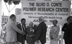 Thumbnail of Roger Porter shaking hands with Corinne Conte
