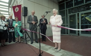 Thumbnail of Dedication ceremonies for the Conte Polymer Center: Corinne Conte cutting the             ribbon