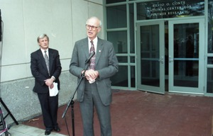 Thumbnail of Dedication ceremonies for the Conte Polymer Center: John Olver addressing the             crowd, David K. Scott in background