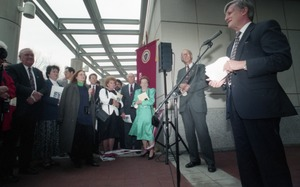 Thumbnail of Dedication ceremonies for the Conte Polymer Center: David K. Scott addressing             the crowd (view toward the crowd), John Olver in background
