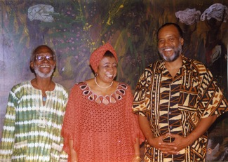 An image of: L to R: Sam Greenlee, Catherine Acholonu, and Everett Hoagland at the Pan-African Writers Association World Poetry Festival in Accra, Ghana, 1999