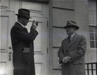 An image of: Blackington photographing Isaac Marcosson, 1936