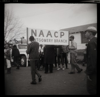 An image of: Marchers carrying sign for NAACP Montgomery branch, ca. March 25, 1965