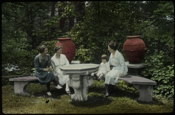 Women and child in a formal garden, ca. 1925