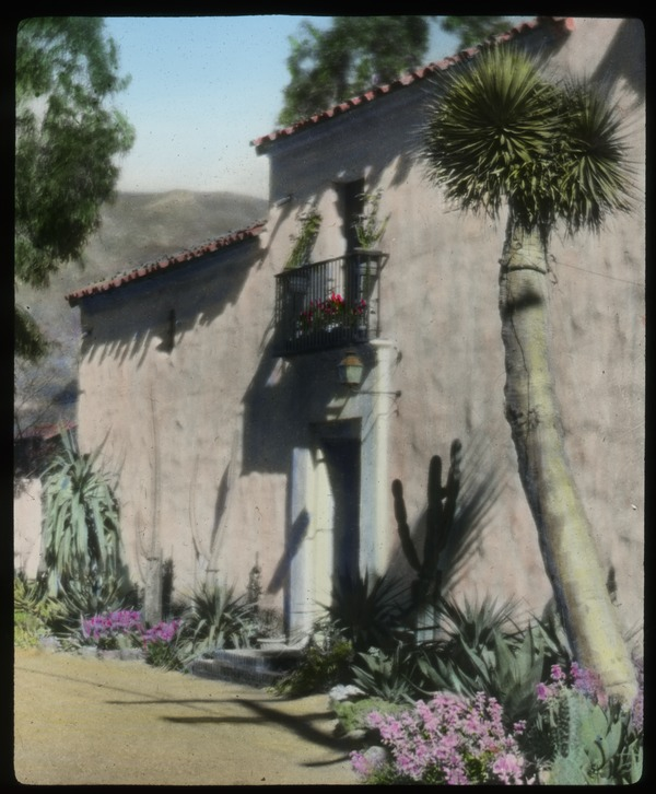 California: cactus and other desert plantings in front of a pink stucco Spanish