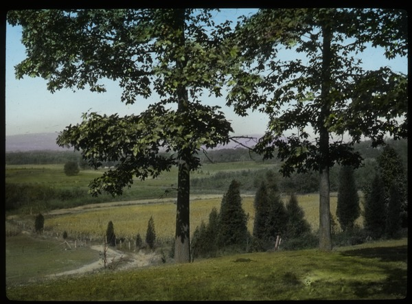 Vista over fields and country road, ca. 1930