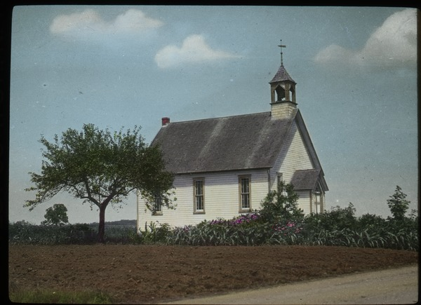 white church or meeting house in field with shrubs and tree), undated