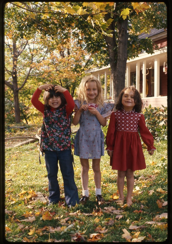 Three girls in front yard of the house, Montague Farm Commune, October 1976