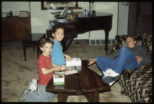 Three children in living room, ca. February 1987