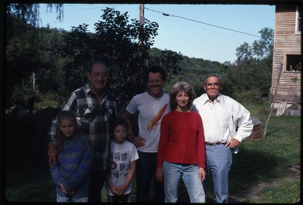 Dan and Nina Keller with two children, Roy Finestone, and unidentified man,