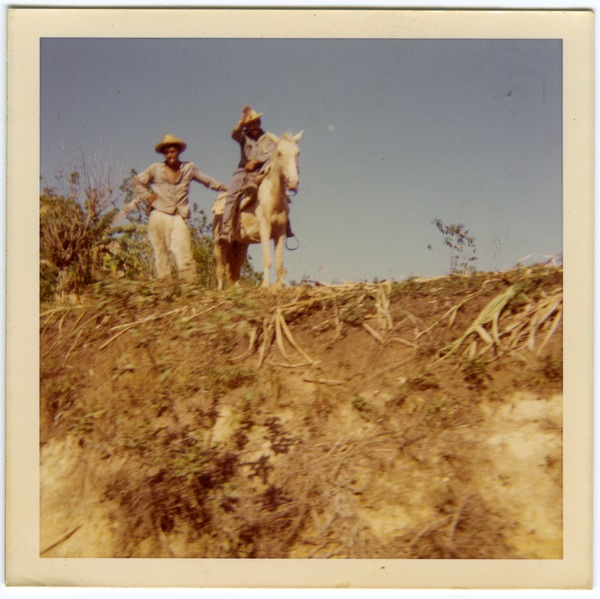 Campesinos (one on horse) waving, 1970
