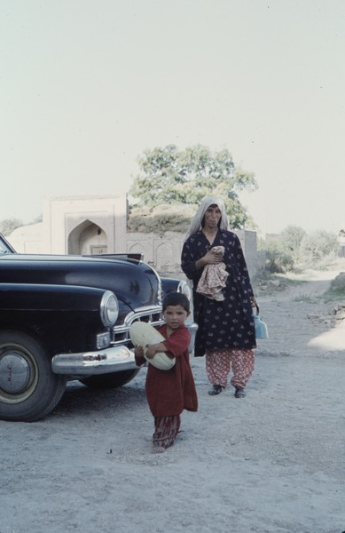 Mother and child with melon, 1961