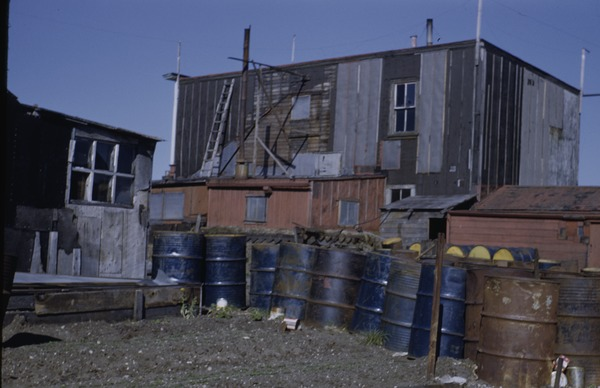 House and oil drums, July 1, 1950
