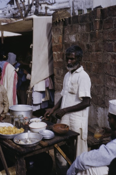 Preparing food to sell at the market in Ranchi, 1956