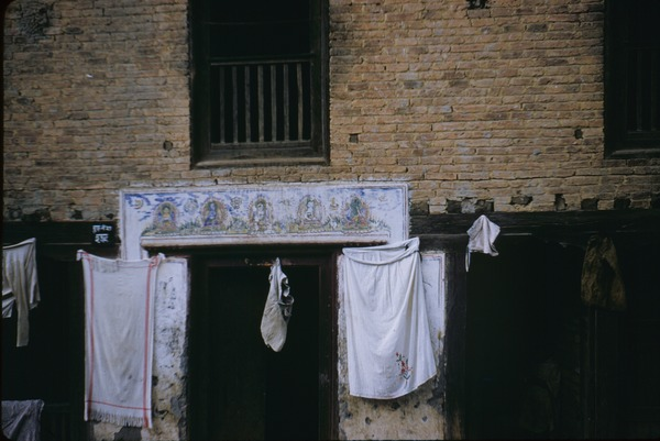 Laundry hanging outside a doorway, 1959