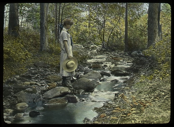 Mt. Toby (young woman on rocks by streamside), ca. 1920