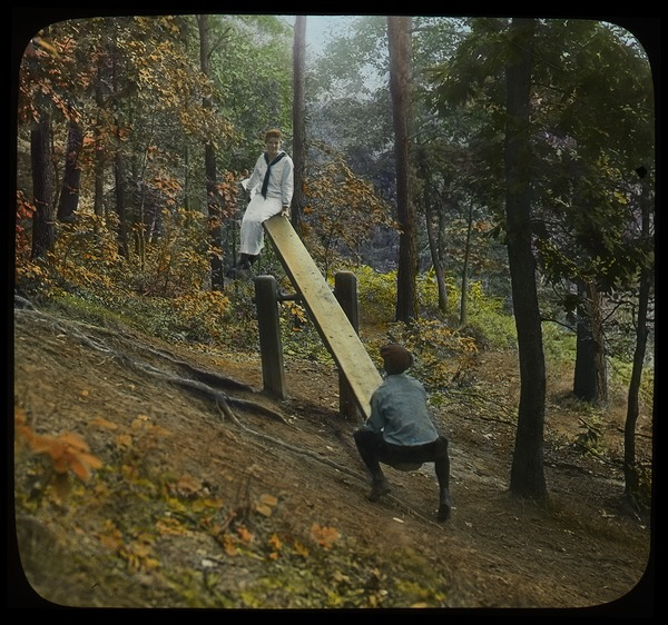 Playground on Sugarloaf (boy and girl on seesaw), ca. 1920