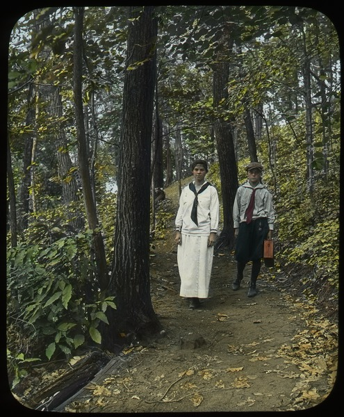 Trail on Sugarloaf (boy and girl walking on wooded trail), ca. 1920