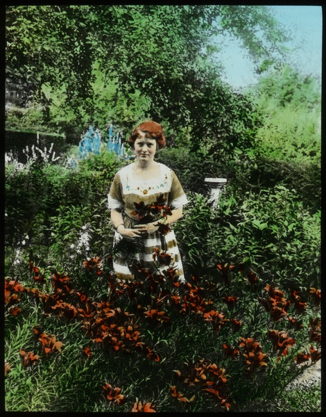 Mrs. Churchill's Garden and daughter (young women standing in garden with lilies), undated