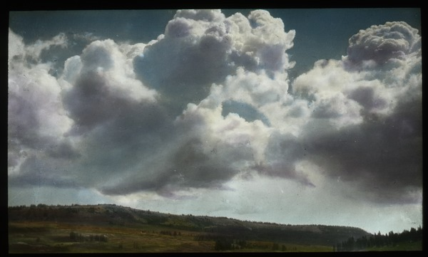 Large clouds over grassy landscape, undated