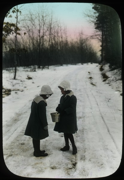Two Girls standing on snowy road, undated
