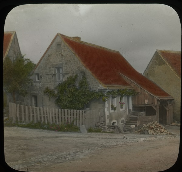 Village scene, Volksberg, Alsaese? (stone house with orange tile shingle roofs), undated