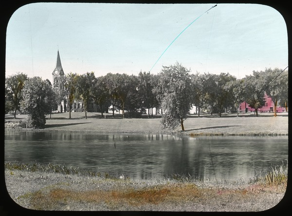 Campus Pond, Old Chapel, and South College, ca. 1925