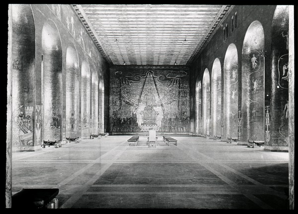 Interior of grand hall with paintings, ca. 1910