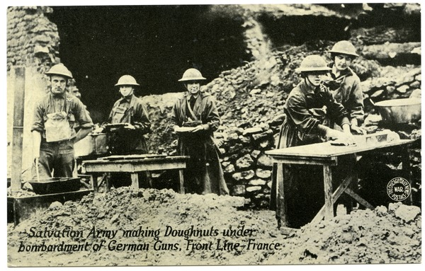 Salvation Army making doughnuts under bombardment of German guns, front line, France, ca. 1918