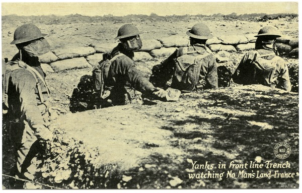 Yanks in front line trench watching no man's land, France, ca. 1918