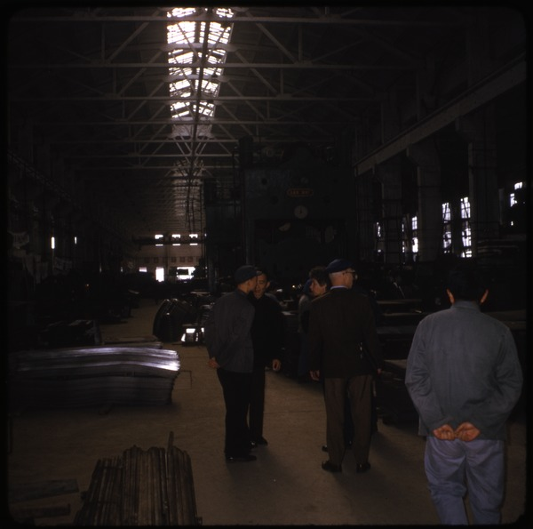 Truck factory: Official guides in Mao suits inspecting the factory floor: , ca. April 10, 1974