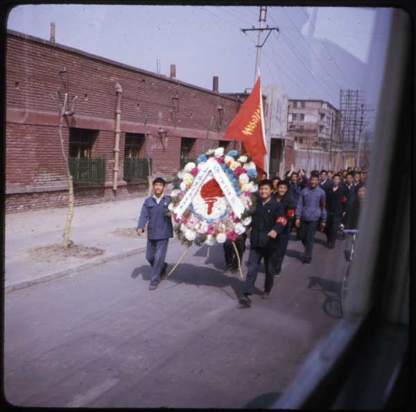 Parade for the martyrs: Procession of men carrying flags and floral wreath: , April 1974
