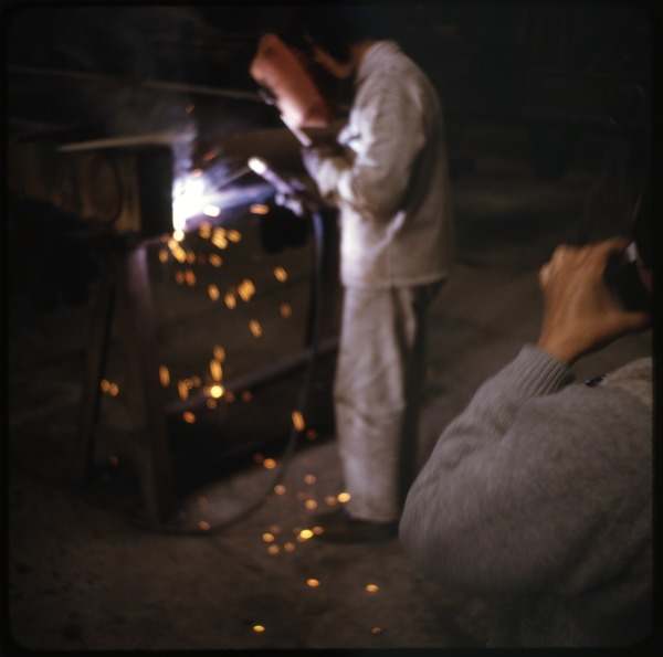 Woman welder at truck factory, ca. April 10, 1974